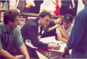 Tarantino, Tim Roth and Chris Penn signing Reservoir Dogs posters. Photo (c)Todd Mecklem